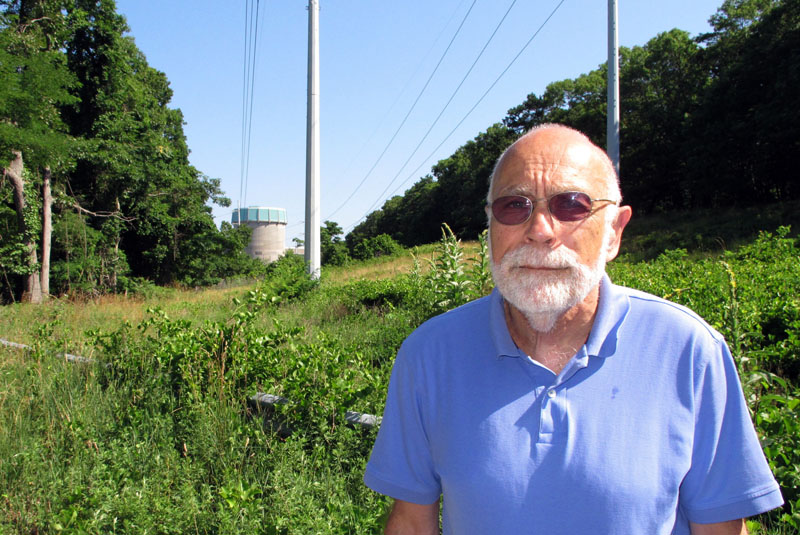 Sid Bail, president of the Wading River Civic Association, poses outside the defunct Shoreham Nuclear Power Plant in Wading River, New York, on July 12, 2016. Photo: AP