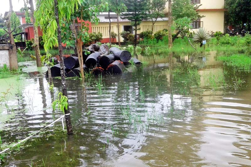 A view of the District Forest Office inundated after heavy downpour, in Sunsari district, on Monday, July 25, 2016. Photo: RSS