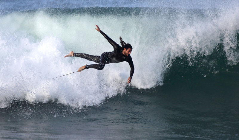Surfer Nicolas Colombo of Argentina flies through the air after wiping out during a winter surf session at Manly Beach on Sydney's north shore in swells generated by a low pressure weather system in Australia, on July 9, 2016. Photo: AP