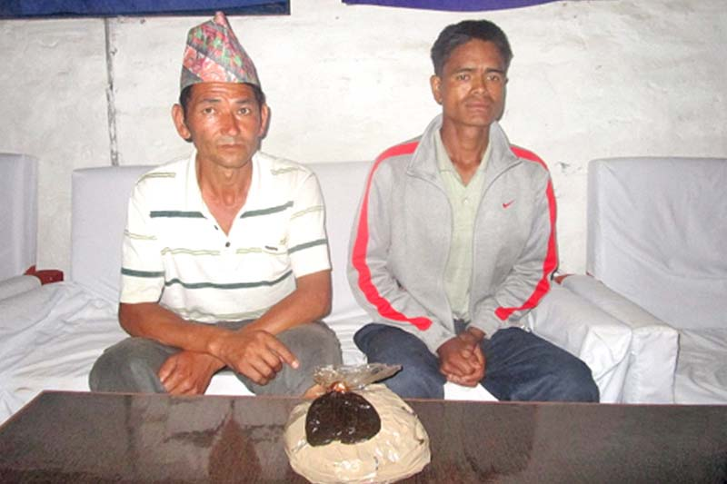 Police make suspects, arrested in possession of opium from Jajarkot, public in the district, on Sunday, July 17, 2016. Photo Courtesy: Narcotics Control Bureau