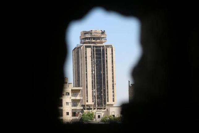 The Municipal Palace in Aleppo city, which is controlled by forces loyal to Syria's President Bashar al-Assad, is pictured from a rebel-held area of Aleppo, Syria July 29, 2016. REUTERS/Abdalrhman Ismail/Files