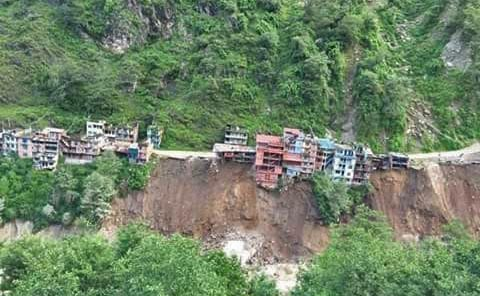 A swollen Bhotekoshi River has pulled down several houses on its bank at Tatopani area of Sindhupalchok district. Photo: Nepal Red Cross Society, Sindhupalchok