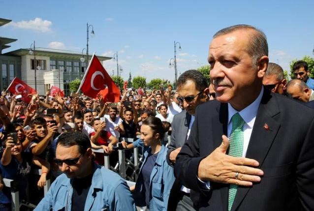 Turkish President Tayyip Erdogan greets his supporters following the Friday prayers in Ankara, Turkey, July 22, 2016. Kayhan Ozer/Presidential Palace/Handout via REUTERS