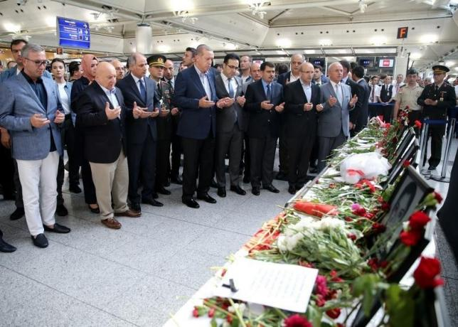 Turkish President Tayyip Erdogan prays for the airport employees who were killed in Tuesday's attack on the airport, during his visit to Ataturk airport in Istanbul, Turkey, July 2, 2016. Murat Cetinmuhurdar/Presidential Palace/Handout via REUTERS