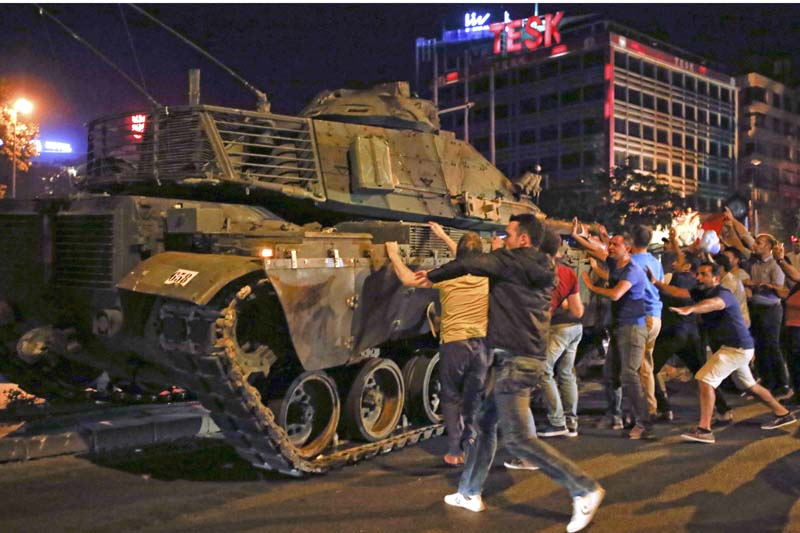 People react near a military vehicle during an attempted coup in Ankara, Turkey, on July 16, 2016. Photo: Reuters