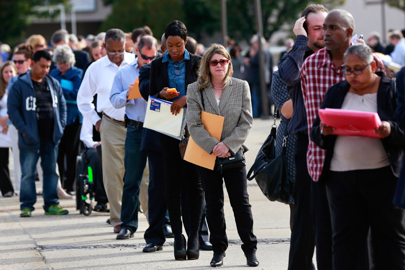 People wait in line to enter the Nassau County Mega Job Fair at Nassau Veterans Memorial Coliseum in Uniondale, New York on October 7, 2014. Photo: REUTERS