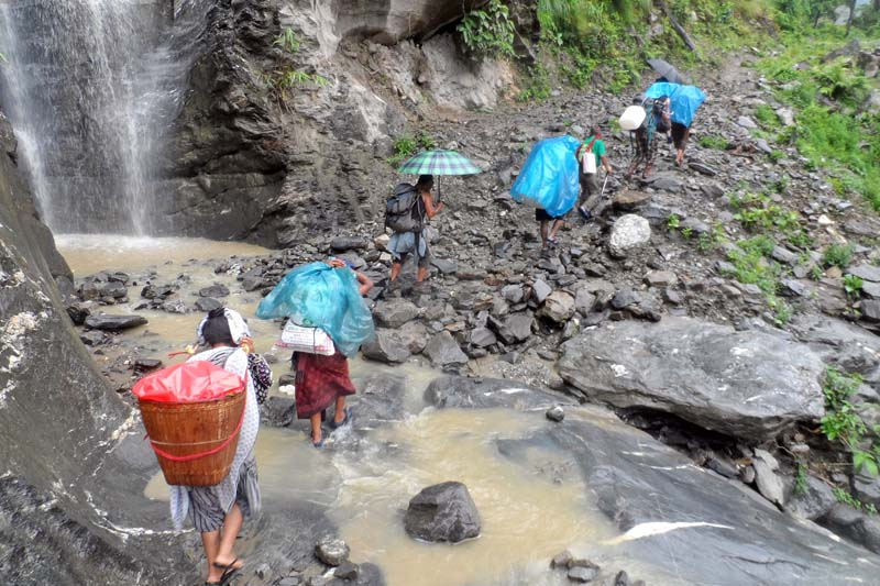 Locals travel in an unsafe way along the Thumi-Lapu section of Manaslu trekking trail, in Gorkha district, on Saturday, July 16, 2016. Photo: RSS