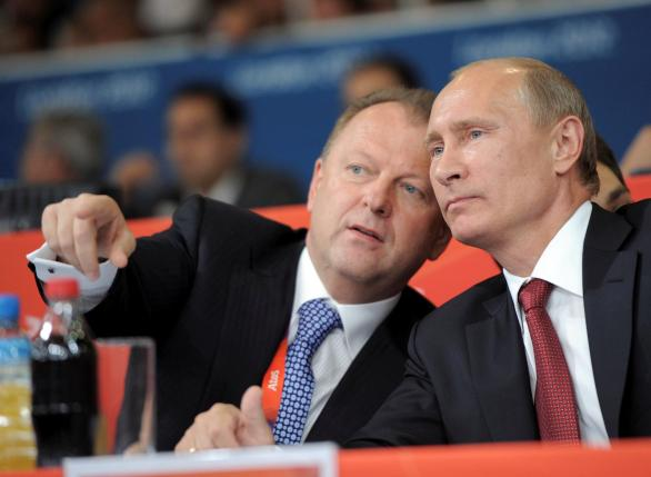 Russian President Vladimir Putin (R) and president of the International Judo Federation (IJF) Marius Vizer chat as they watch the final of the judo competition at the London 2012 Olympic Games, Britain, August 2, 2012. Sputnik/Kremlin/Alexei Druzhinin/via REUTERS
