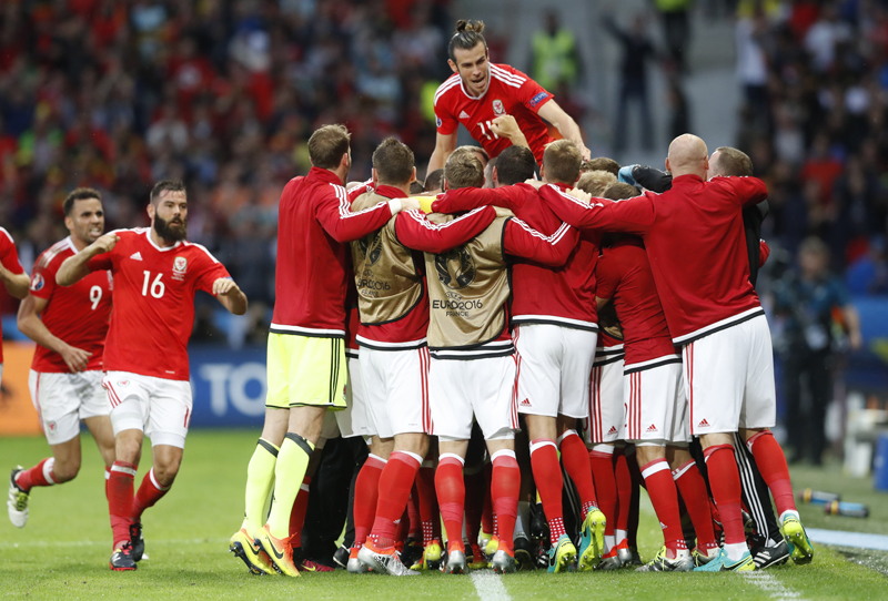 Wales' Ashley Williams celebrates with teammates after scoring their first goal nagainst Belgium during Euro 2016 quarter final at Stade Pierre-Mauroy, in Lille, on Friday, July 1, 2016. Photo: Reuters