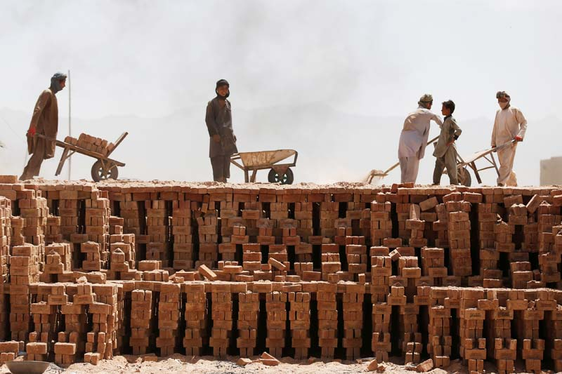 Labourers work at a brick factory on the outskirts of Kabul, Afghanistan on July 18, 2016. Photo: Reuters