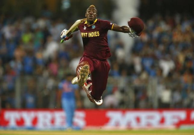Cricket - West Indies v India - World Twenty20 cricket tournament semi-final - Mumbai, India - 31/03/2016. West Indies Andre Russell celebrates after winning their match.   REUTERS/Danish Siddiqui