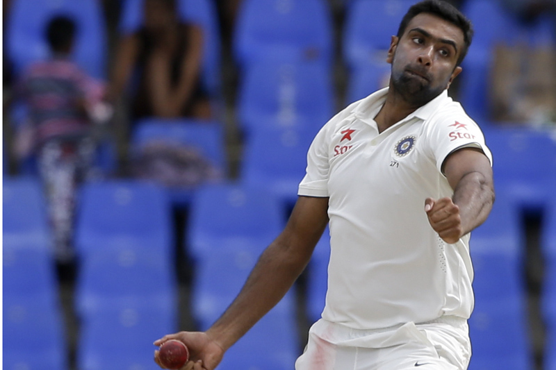 India's Ravichandran Ashwin bowls against West Indies during day four of their first cricket Test match at the Sir Vivian Richards Stadium in North Sound, Antigua, Sunday, July 24, 2016. Ashwin took seven wickets. (AP Photo/Ricardo Mazalan)
