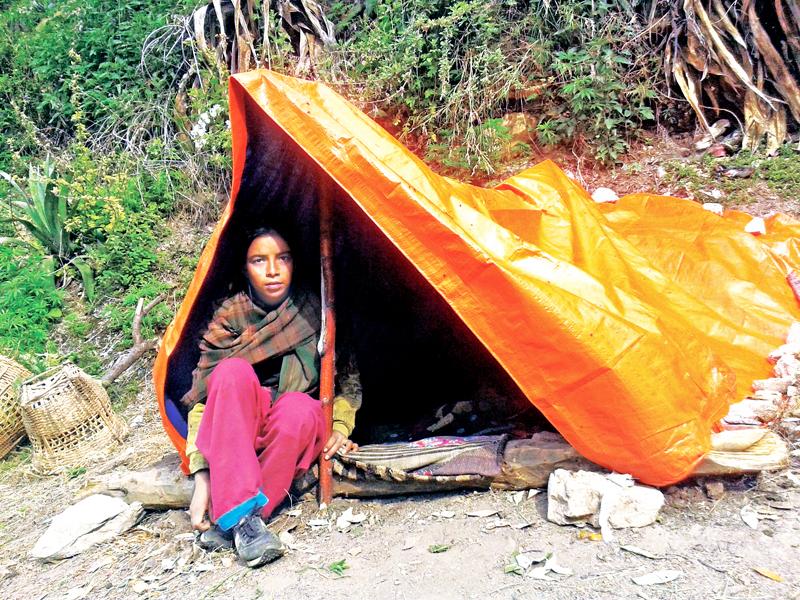 An eighth grader girl sheltering under a tent during menstruation in Kolti, Bajura, on Thursday, July 21, 2016. Photo: THT