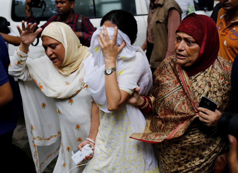 People react near the Holey Artisan restaurant after Islamist militants attacked the upscale cafe in Dhaka, Bangladesh, July 2, 2016.  Photo: Reuters/File