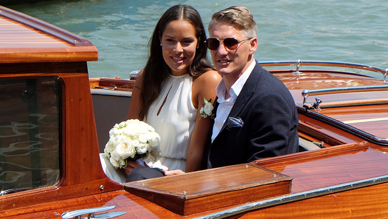 German football player Bastian Schweinsteiger and Serbian tennis player Ana Ivanovic sit in a boat after get married in Venice, Italy, July 13, 2016. Photo: Reuters