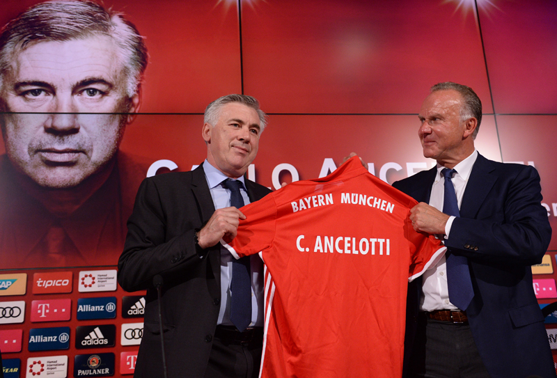 Carlo Ancelotti , left, new head coach of German Bundesliga soccer club of FCu00a0Bayern Munich,  receives a special jersey from  FC Bayern Munich CEO Karl-Heinz Rummenigge, right,  during a press conference held at the Allianz Arena in Munich,u00a0Germany, Monday July 11, 2016. Photo: AP