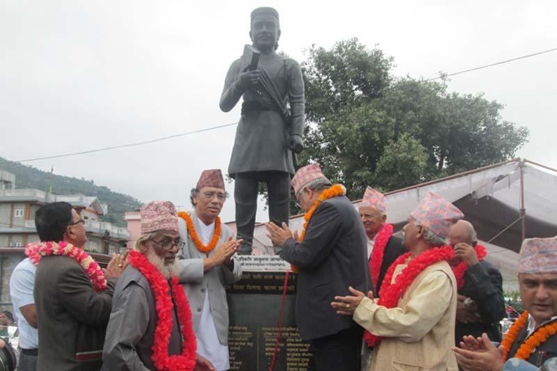Nepal Academy of Music and Drama Chancellor Sarubhakta unveils a life-size idol of Aadikavi Bhanu Bhakta Acharya in Pokhara of Kaski on the occasion of the 203rd Bhanu Jayanti on Wednesday. Photo: Rishi Ram Baral
