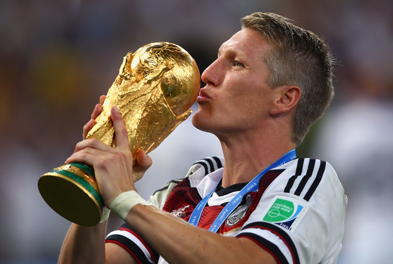File photo of Bastian Schweinsteiger, kisses the World Cup trophy after defeating Argentina in the world cup final in Brazil. Photo: AP