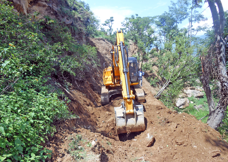 Rural roads being constructed haphazardly with the use of bulldozers in Bahrabisa VDC, Bajura, on Thursday, July 28, 2016. Photo: THT