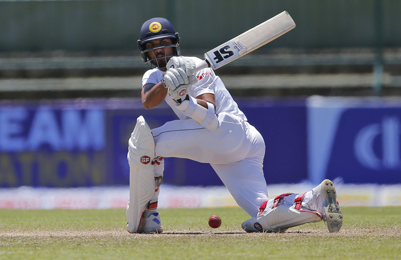Sri Lanka's Dinesh Chandimal plays a shot on day three of the first test cricket match between Sri Lanka and Australia in Pallekele, Sri Lanka, Thursday, July 28, 2016. Photo: AP