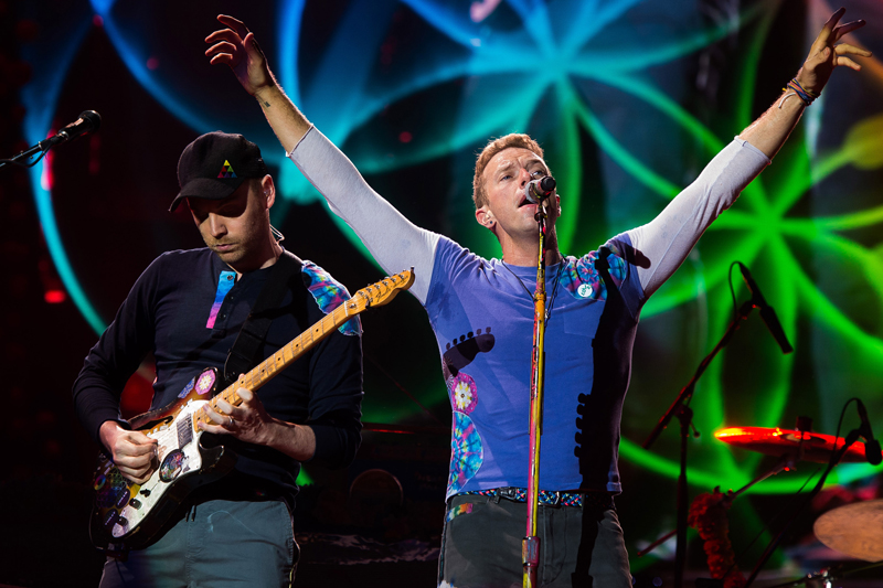 Chris Martin, right, and Jonny Buckland from the band Coldplay perform at MetLife Stadium on Saturday, July 16, 2016, in East Rutherford, New Jersey. Photo: AP