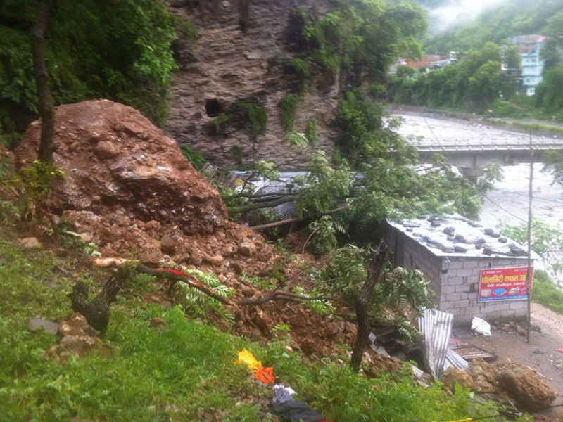 A cotton factory buried by a landslide triggered by incessant rainfall in Manjhphant-2 of Parbat on Tuesday, July 26, 2016. Photo: RSS