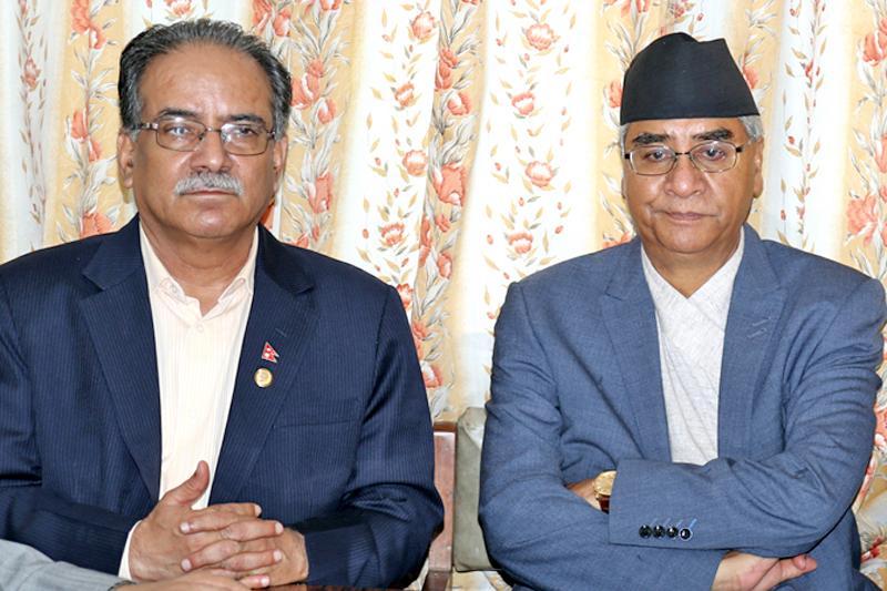CPN-Maoist Centre Chairman Pushpa Kamal Dahal (left) and Nepali Congress President Sher Bahadur Deuba attend a meeting at Singha Durbar in Kathmandu, on Friday, July 22, 2016. Photo: RSS