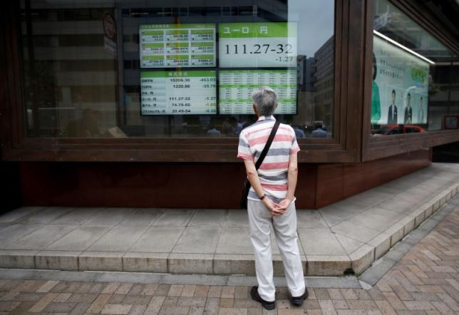 A man looks at an electronic board showing the Japanese yen's exchange rate against Euro outside a brokerage in Tokyo, Japan, July 6, 2016. REUTERS/Issei Kato
