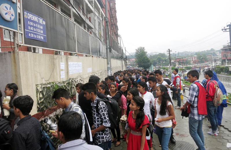 SLC graduates line up to appear in an entrance test to get enrolled at the St Xavier's College, in Maitighar of Kathmandu, on Saturday, July 2, 2016. More than 13,000 students had applied for 504 seats at the institution. Photo: RSS