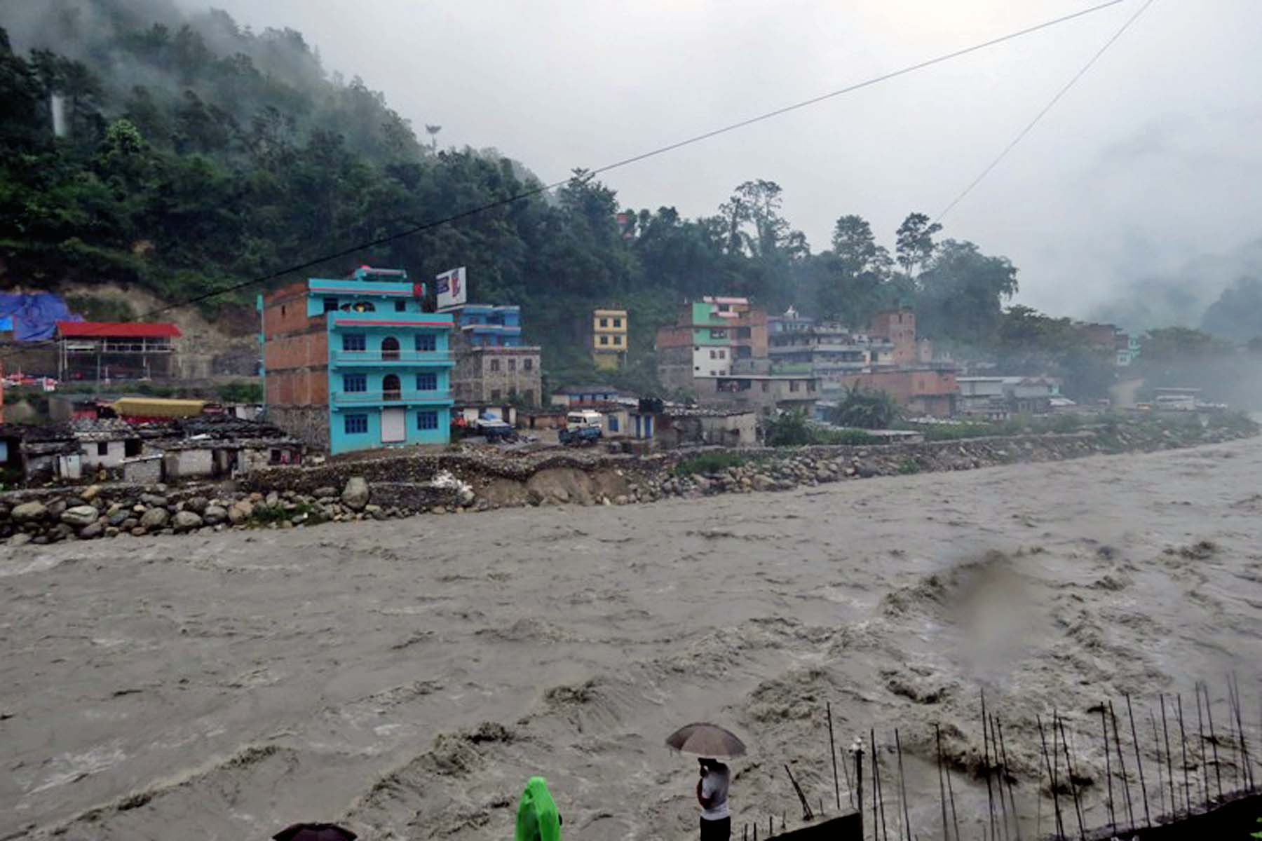 A flash flood occurs after the incessant rainfall in Beni Bazaar, the district headquarters of Myagdi district, on Saturday, July 02, 2016. Photo: RSS
