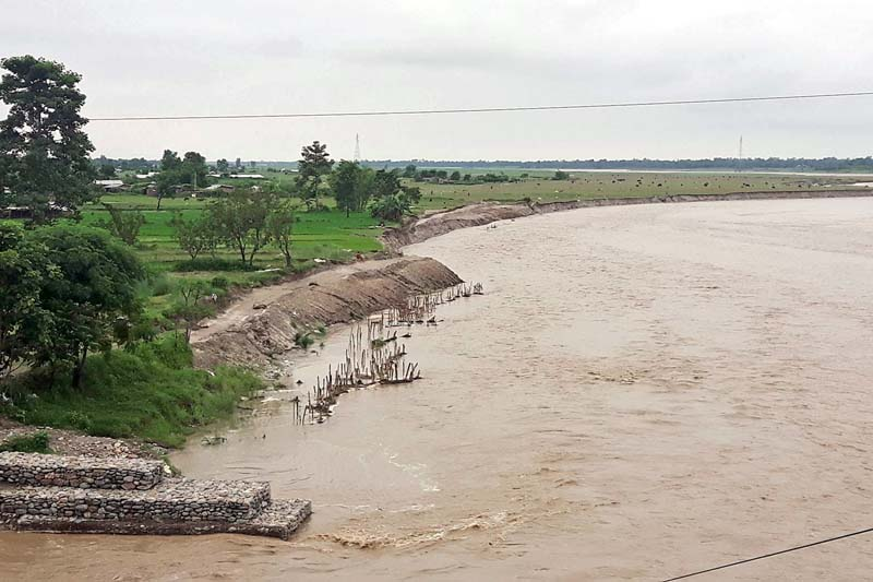 FILE - A flooded Kankai River flows in Kotihom area of Jhapa district, on Monday, July 25, 2016. Photo: RSS