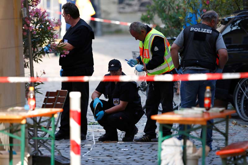 Police secure the area after an explosion in Ansbach, Germany on July 25, 2016. Photo: Reuters