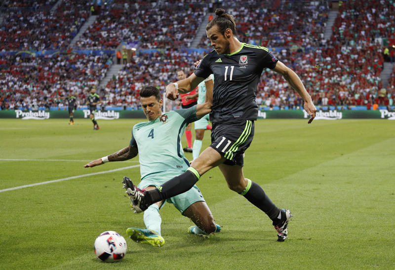 Wales' Gareth Bale in action with Portugal's Jose Fonte nduring Euro 2016 Semi-final at Stade de Lyon, in Lyon on Wednesday, July 6, 2016. Photo: Reuters