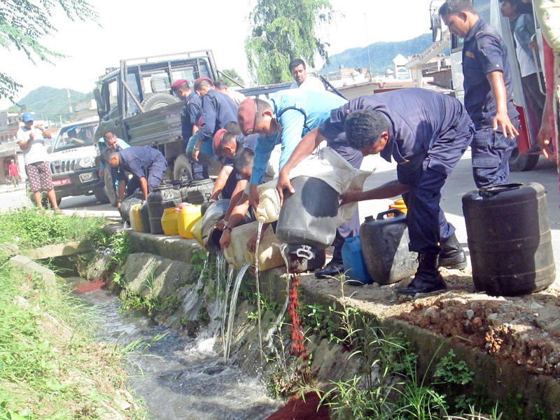 Police destroying illegally brewed alcohol in front of Tanahun District Police Office in Damauli on Wednesday, July 13, 2016. Photo: Madan Wagle