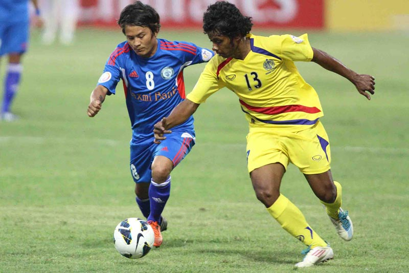 Jagjeet Shrestha (left) of Three Star Club vies for the ball against Siraji of Abahani Limited of Bangladesh during the AFC President's Cup Group 'A' Qualifiers at the Dasharath Stadium in Kathmandu. Photo: Udipt Singh Chhetry/THT File