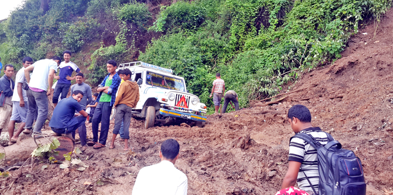 Passengers look dejected after a jeep they were travelling on gets stuck after a landslide blocked the Jajarkot-Dolpa road section at Shanti Chautara in Khalanga in Jajarkot district, on Friday, July 29, 2016. Photo: RSS