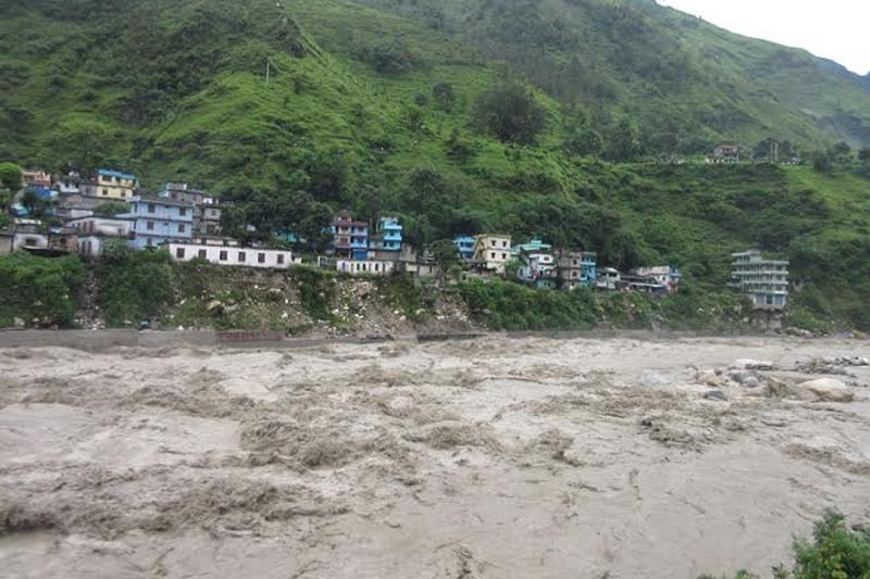 The surging water level in Mahakali River on Sunday July 17, 2016. Headquarter Khalanga is at high risk of flood due to rising water level. Photo: Tekendra Deuban