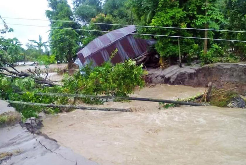 A house being pulled down by floods in Bakra Khola at Khabejhoda of Madhumalla in Morang district on Tuesday, July 26. Photo: RSS
