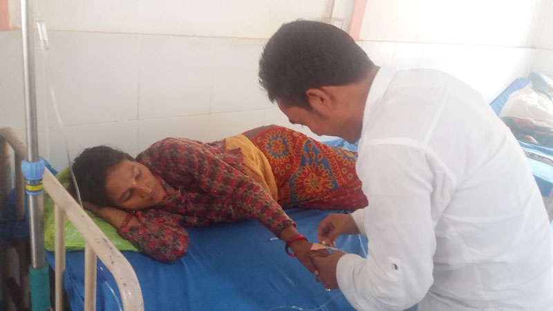 Binita Sunar, the mother of baby born with birth defect receives treatment at emergency ward in Bayalpata Hospital, in Bajura district, on Tuesday, July 12, 2016. Photo: Prakash Singh