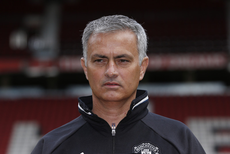 New Manchester United manager Jose Mourinho poses ahead of the press conferencen at Old Trafford on July 6, 2016. Photo: Reuters