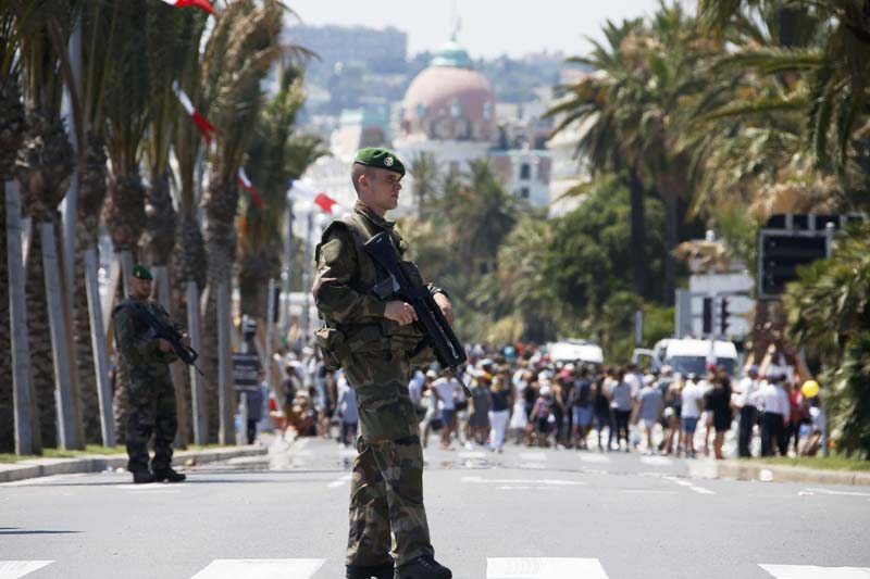 Soldiers from the French Foreign Legion patrol on the Promenade des Anglais on the third day of national mourning to pay tribute to victims of the truck attack on Bastille Day in Nice, France on July 18, 2016. Photo: Reuters