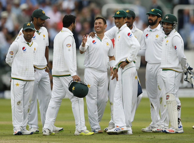 Pakistan's Yasir Shah celebrates with team mates after taking the wicket of England's Jonny Bairstown during First Test match at Lord's on Friday, July 15, 2016. Photo: Reuters