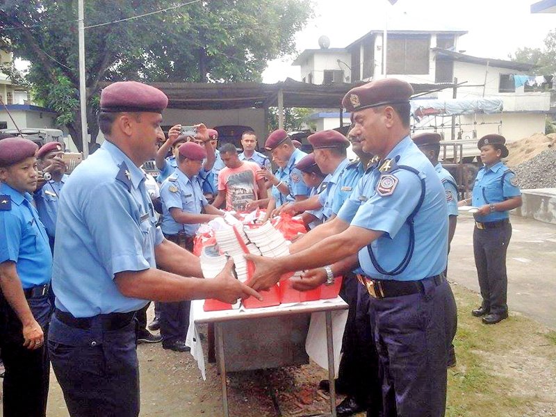 SSP Uttam Bahadur Singh (right) of Sagarmatha Zonal Police nOffice handing out materials to the concerned police unit in-charges, in District Police Office, Rajbiraj, Saptari, on Sunday, July 17, 2016. Photo: THT