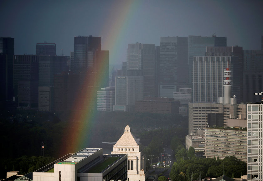 A rainbow can be seen over the parliament building in Tokyo, Japan on Monday, July 4, 2016. Photo: Reuters