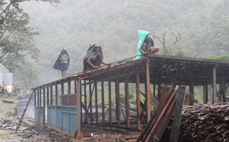 FILE: Earthquake survivors in Thumi village in Gorkha district construct their house as they lost their residence in the 2015 earthquake, on Sunday, July 17, 2016. After the government did not provide the committed grant assistance to them on time, locals have begun reconstruction on their own. Photo: RSS