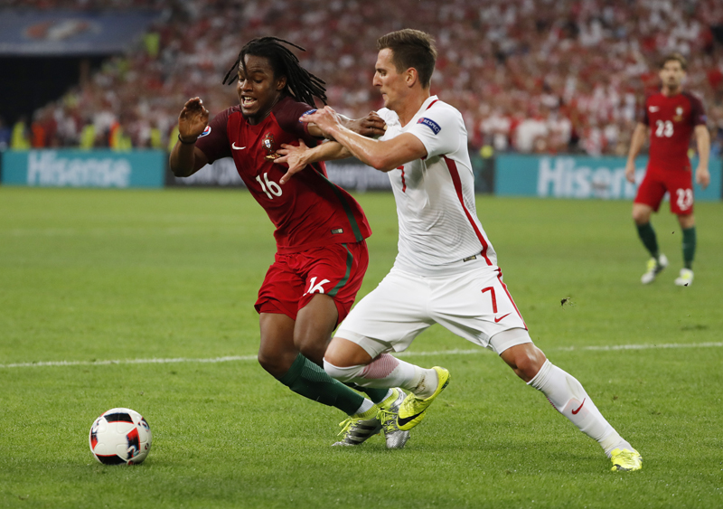 Portugal's Renato Sanches in action with Poland's Arkadiusz Milik nduring Euro 2016 quater final at Stade Velodrome,in Marseille, on Thursday, June 30, 2016. Photo: Reuters