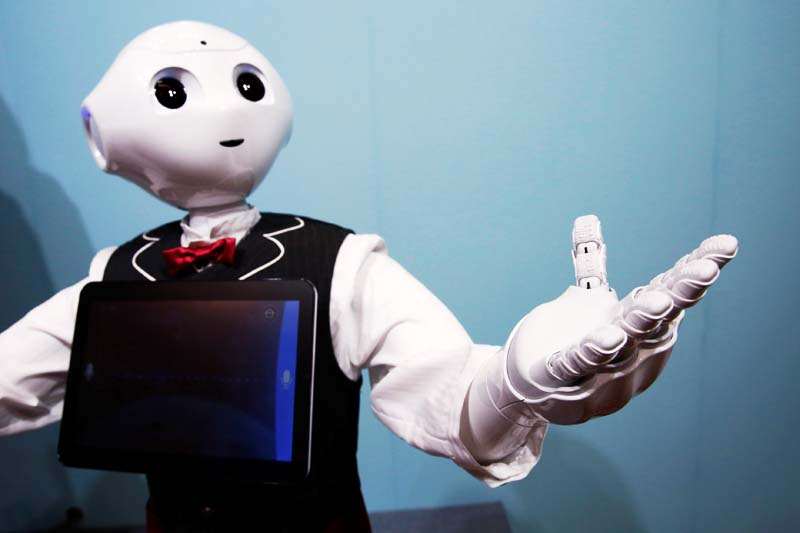 SoftBank humanoid robot known as Pepper dressed as a waiter moves its hand at Pepper World 2016 Summer during SoftBank World 2016 conference in Tokyo, Japan on July 21, 2016. Photo: Reuters