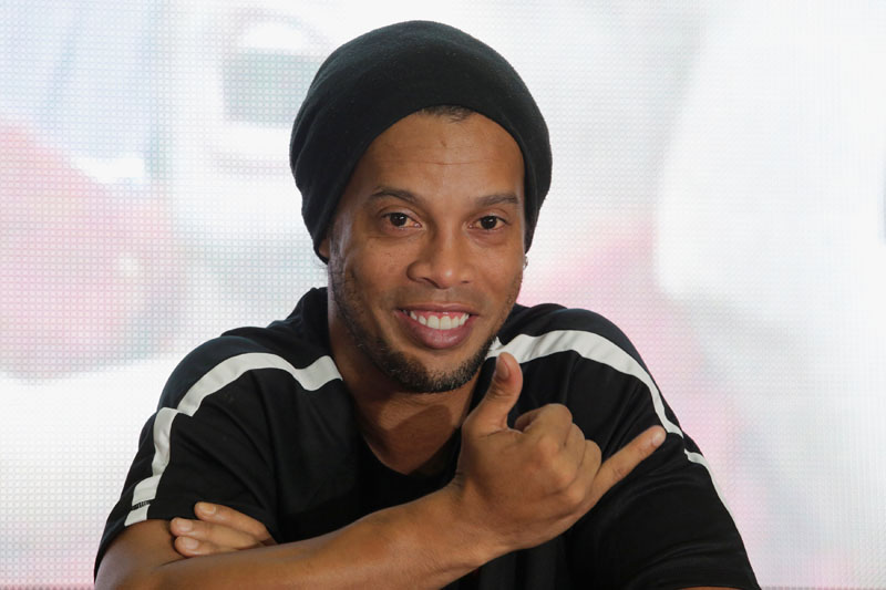 Brazilian soccer player Ronaldinho attends a news conference upon his arrival to Guatemala to promote a friendly soccer match with local teams, in Guatemala City, Guatemala, July 8, 2016. REUTERS/File