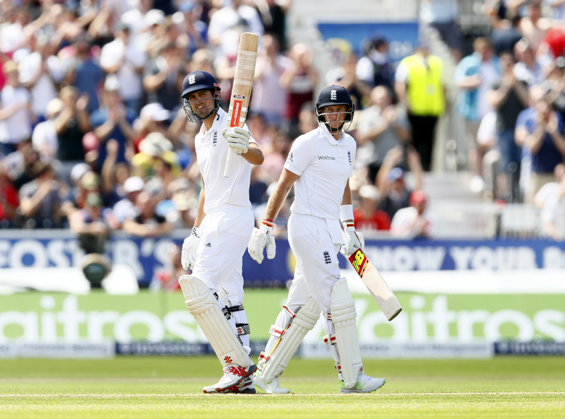 England's Alastair Cook celebrates his half century as Joe Root looks on during Second Test match against Pakistan at Old Trafford on Friday, July 22, 2016. Photo: Reuters