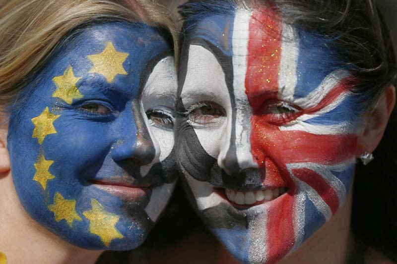 Protestors with their faces  painted pose for a photograph during a 'March for Europe' demonstration against Britain's decision to leave the European Union, in central London, Britain, on July 2, 2016. Photo: Reuters